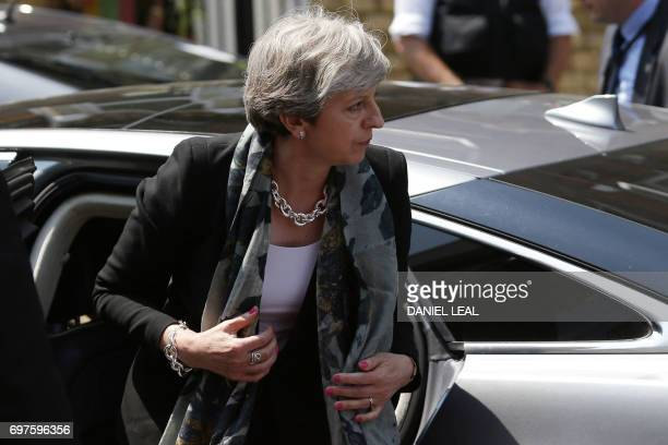 British Prime Minister Theresa May arrives at Finsbury Park Mosque in the Finsbury Park area of north London on June 19 after a vehicle was driven...
