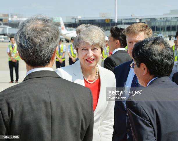 British Prime Minister Theresa May arrives at Osaka International Airport, western Japan, on Aug. 30 for a three-day visit, during which she is...