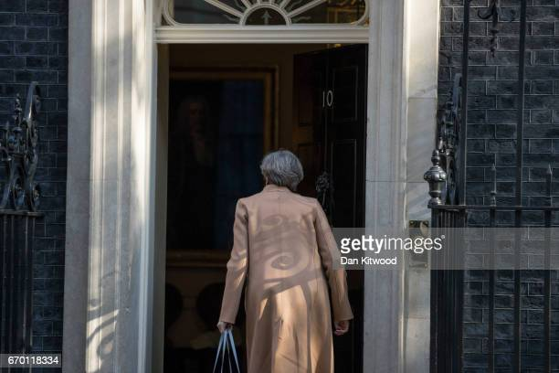 British Prime Minister Theresa May arrives back at 10 Downing Street after conducting radio interviews on April 19 2017 in London England Mrs May...