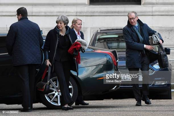 British Prime Minister Theresa May arrives for work this morning via the back door of Downing Street after a weekend at her country home in Sonning...