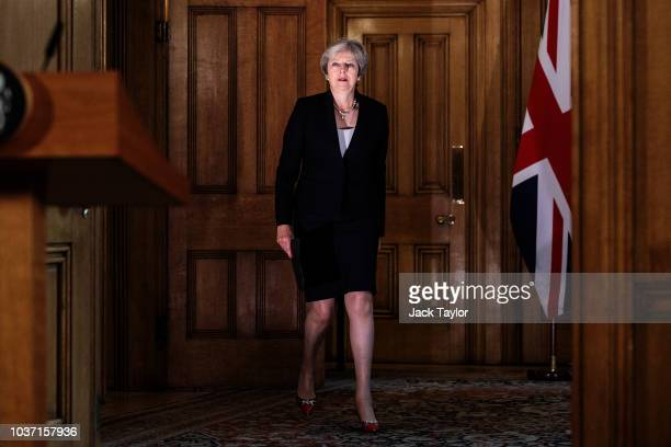 British Prime Minister Theresa May arrives to make a statement on Brexit negotiations with the European Union at Number 10 Downing Street on...