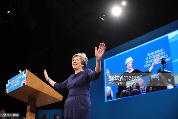 British Prime Minister Theresa May arrives to make her keynote speech to delegates and party members on the last day of the Conservative Party...