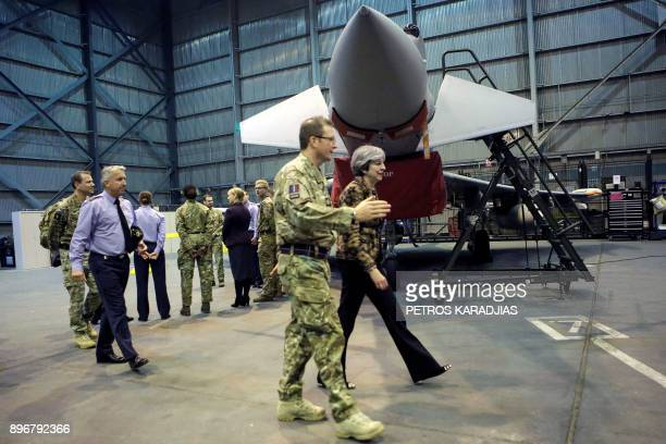 British Prime Minister Theresa May arrives to meet troops and wish British servicemen happy holidays at the RAF Akrotiri British military base in the...