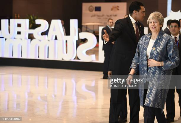 British Prime Minister Theresa May arrives to the International Congress Centre on February 24 ahead of first joint European Union and Arab League...