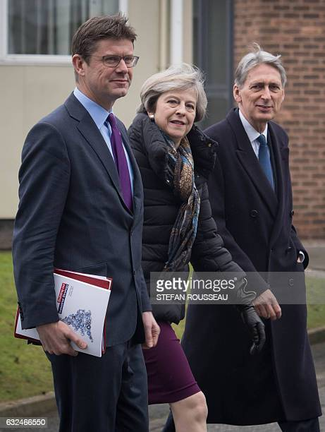 British Prime Minister Theresa May arrives with colleagues British Chancellor of the Exchequer Philip Hammond and British Business Energy and...