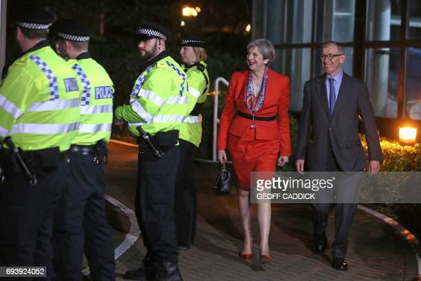 TOPSHOT British Prime Minister Theresa May arrives with her husband Philip at the count centre in Maidenhead early in the morning of June 9 hours...