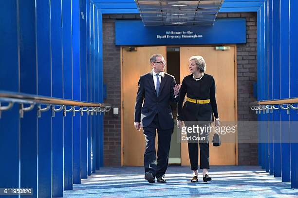British Prime Minister Theresa May arrives with her husband Philip May ahead of delivering a speech to delegates and party members about Brexit on...