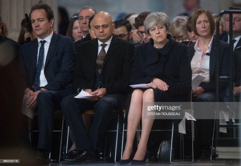 British Prime Minister Theresa May attends a Grenfell Tower National Memorial service at St Paul's cathedral on December 14, 2017 in central London. The fire on June 14 in the Grenfell tower apartment block claimed 71 lives making it the worst fire in the United Kingdom since World War II. / AFP PHOTO / POOL / Stefan Rousseau