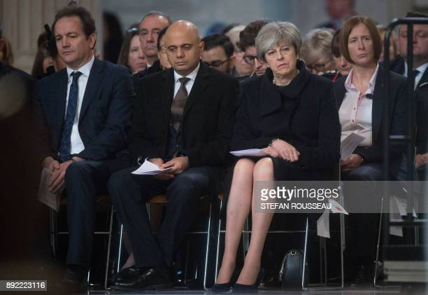 British Prime Minister Theresa May attends a Grenfell Tower National Memorial service at St Paul's cathedral on December 14 2017 in central London...