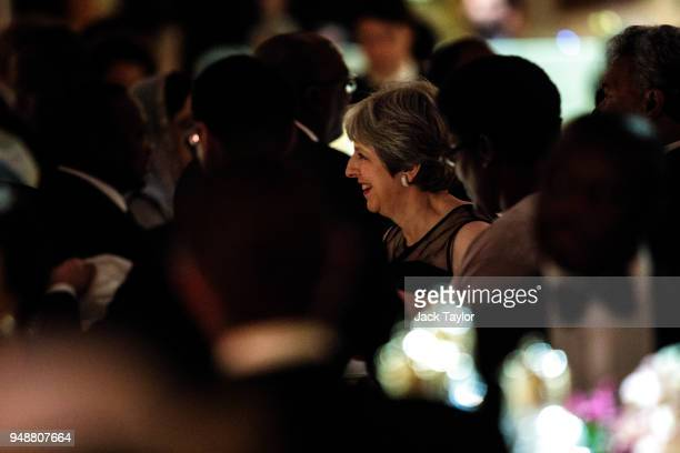 British Prime Minister Theresa May attends the Queen's Dinner at Buckingham Palace in the week of the 'Commonwealth Heads of Government Meeting' on...