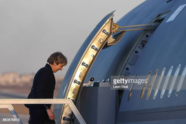 British Prime Minister Theresa May boards a plane to fly back to the UK on November 30 2017 in Amman Jordan Theresa May has visited Iraq Saudi Arabia...