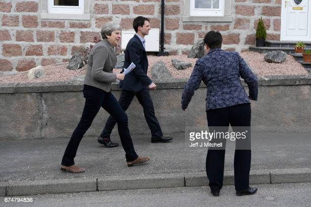 British Prime Minister Theresa May campaigns on the streets with Scottish Conservative leader Ruth Davidson on April 29 2017 in Banchory Scotland The...