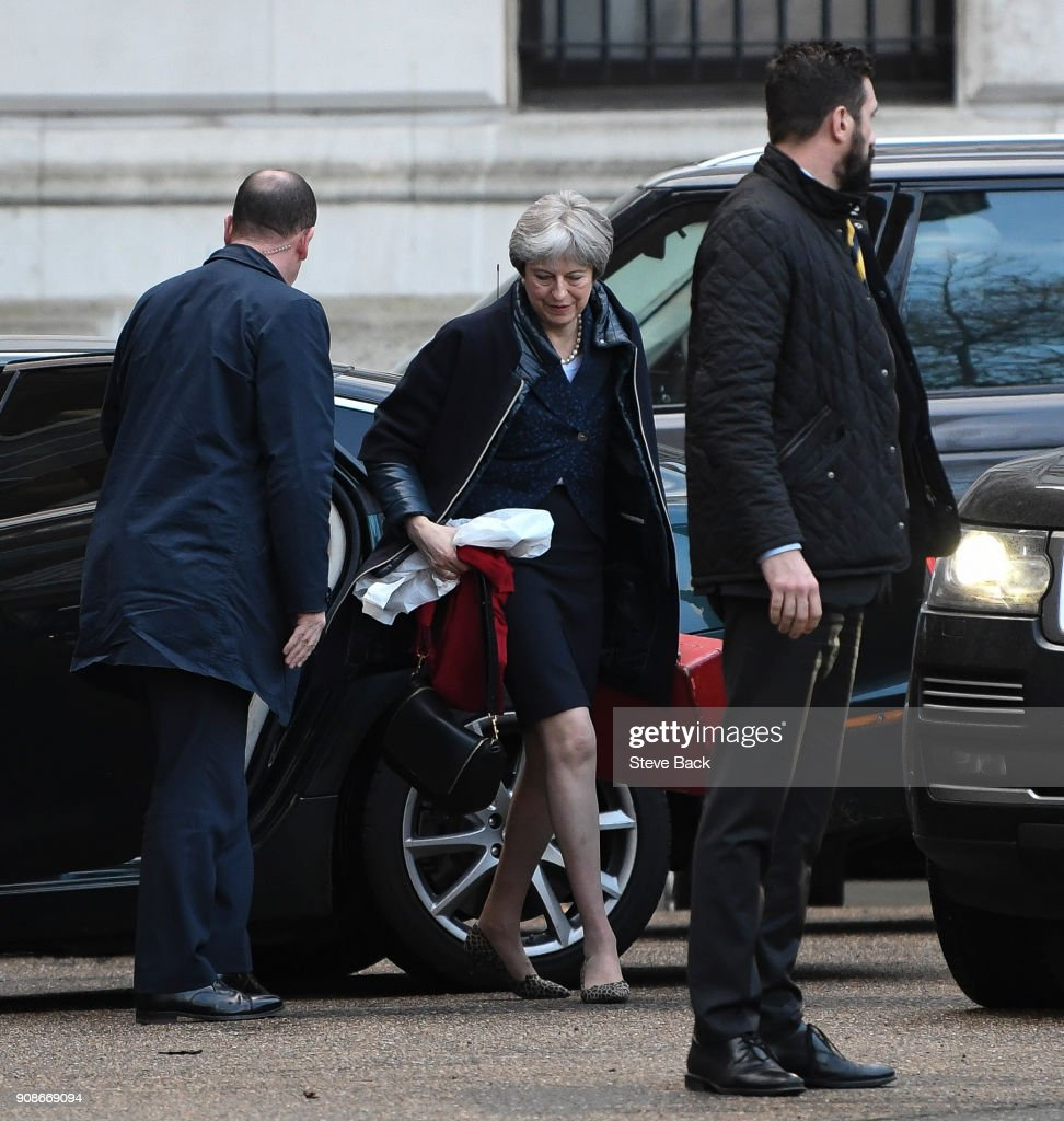 LONDON, ENGLAND - JANUARY 22, British Prime Minister Theresa May carrying her belongings in a plastic bag arrives for work this morning via the back door of Downing Street after a a weekend at her country home in Sonning on January 22, 2018 in London, England.