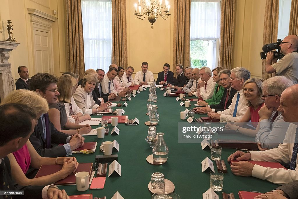 TOPSHOT - British Prime Minister Theresa May (7th L) chairs her first Cabinet meeting in 10 Downing Street in London on July 19, 2016. Prime Minister Theresa May warned Monday that the threat from nuclear weapons was increasing as she pressed MPs to approve the replacement of the ageing submarines that carry Britain's nuclear arsenal. / AFP / POOL / Dan Kitwood