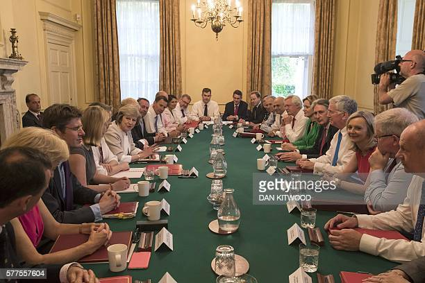 TOPSHOT British Prime Minister Theresa May chairs her first Cabinet meeting in 10 Downing Street in London on July 19 2016 Prime Minister Theresa May...