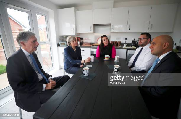 British Prime Minister Theresa May Chancellor of the Exchequer Philip Hammond and Secretary of State for Communities and Local Government Sajid Javid...