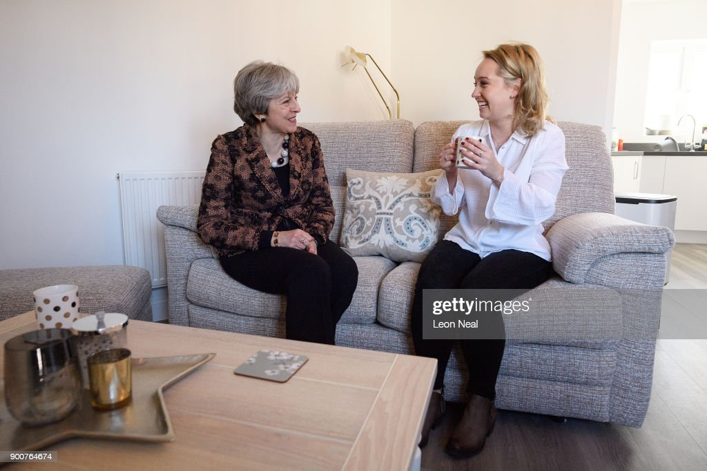 British Prime Minister Theresa May (L) chats with first-time buyer Laura Paine during a visit to new housing development Montague Park on January 3, 2018 in Wokingham, England. The Government has today claimed that 16,000 first-time buyers have benefited from changes to the stamp duty rules.