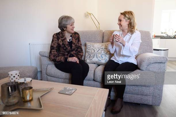 British Prime Minister Theresa May chats with firsttime buyer Laura Paine during a visit to new housing development Montague Park on January 3 2018...