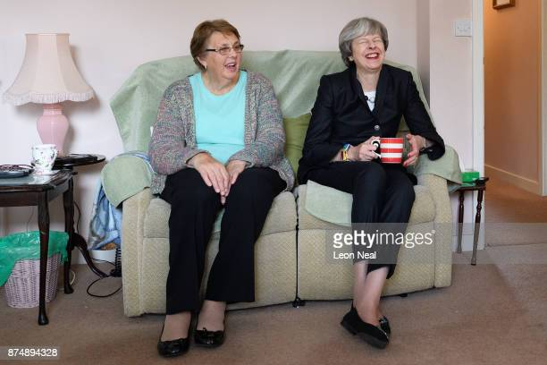 British Prime Minister Theresa May chats with resident Val Lay during a visit to a housing estate on November 16 2017 in London England Mrs May has...