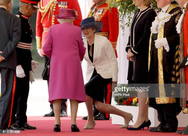 British Prime Minister Theresa May curtsies as Britain's Queen Elizabeth II arrives at a Ceremonial Welcome for Spain's King Felipe and Queen Letizia...