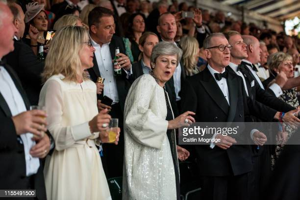 British Prime Minister Theresa May dances to Björn Again's performance of Dancing Queen at Henley Festival on July 13, 2019 in Henley-on-Thames,...
