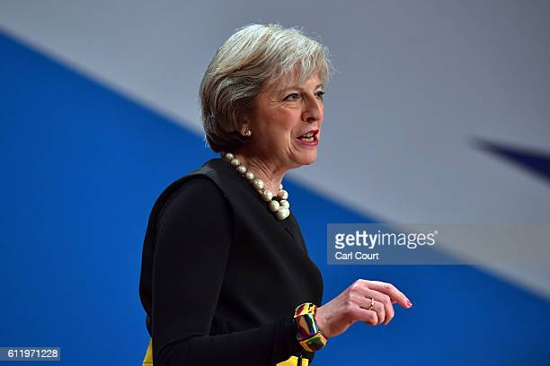British Prime Minister Theresa May delivers a speech about Brexit on the first day of the Conservative Party Conference 2016 at the ICC Birmingham on...