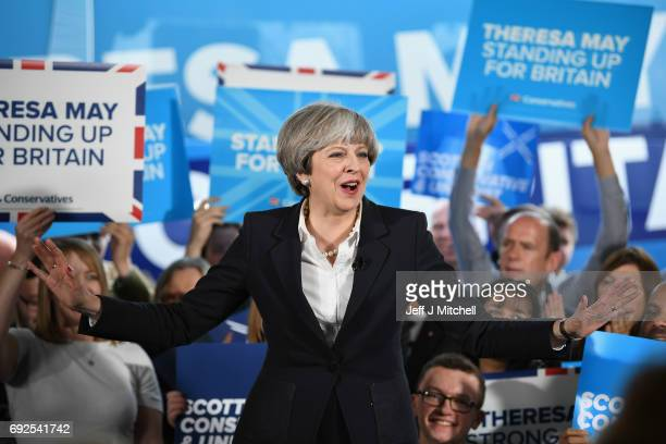 British Prime Minister Theresa May delivers a speech at Clockwork Removals as the Conservative election campaign resumes on June 5 2017 in Edinburgh...