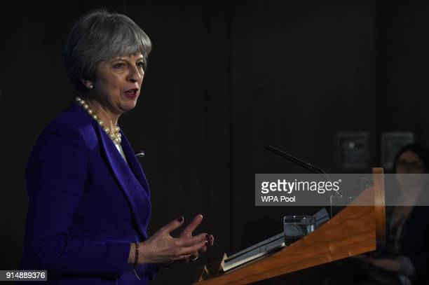British Prime Minister Theresa May delivers a speech on public life to mark the centenary of women's suffrage in the UK on February 6 2018 in...