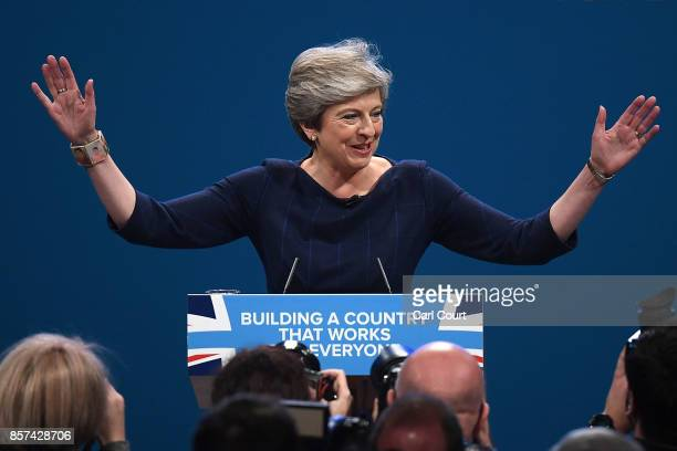 British Prime Minister Theresa May delivers her keynote speech to delegates and party members on the last day of the Conservative Party Conference at...