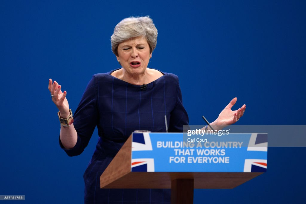 British Prime Minister Theresa May delivers her keynote speech to delegates and party members on the last day of the Conservative Party Conference at Manchester Central on October 4, 2017 in Manchester, England. The prime minister rallied members and called for the party to 'shape up' and 'go forward together'. Theresa May also announced a major programme to build council houses and a cap on energy prices.