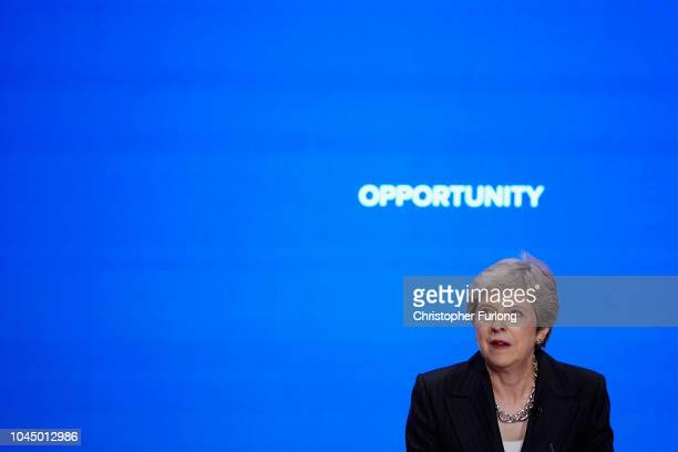British Prime Minister Theresa May delivers her leader's speech during the final day of the Conservative Party Conference at The International...