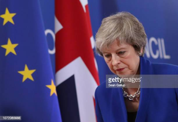 British Prime Minister Theresa May departs after speaking at a press conference after attending a special session of the European Council over Brexit...