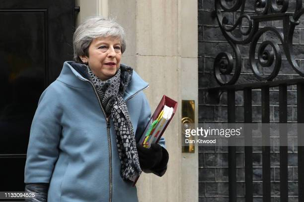 British Prime Minister Theresa May departs number 10 Downing Street for The Houses of Parliament on March 27 2019 in London England Today MPs will...