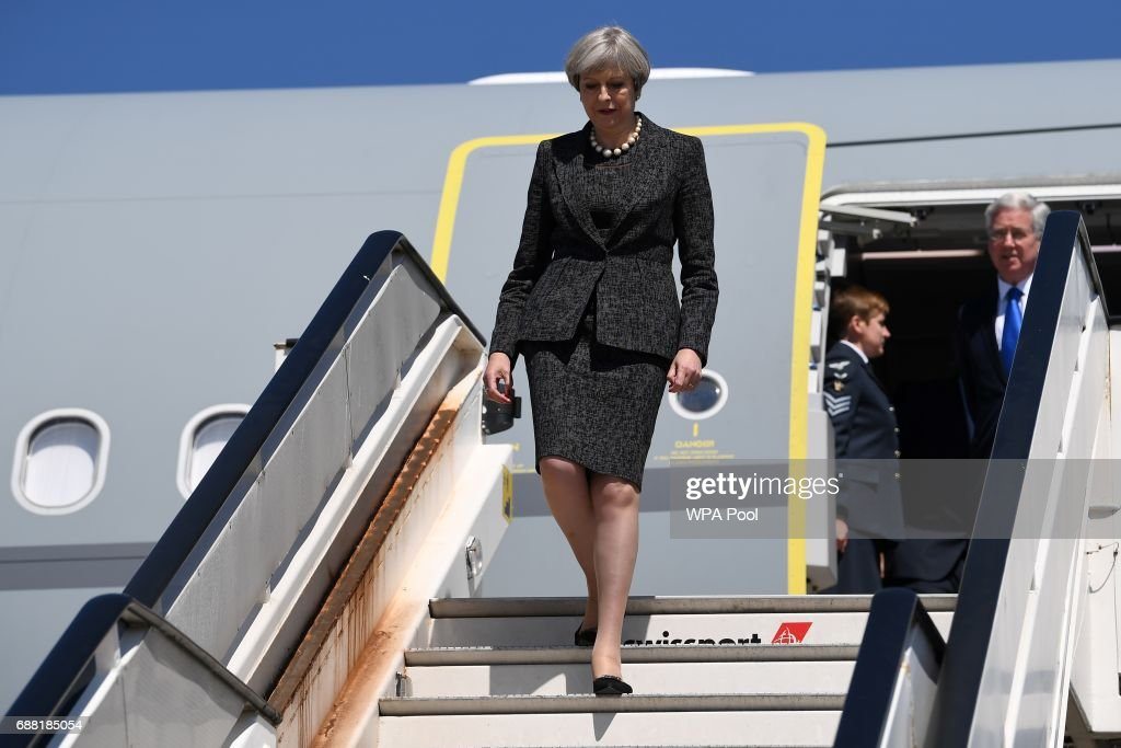 British Prime Minister Theresa May disembarks a plane as she arrives to attend a NATO summit meeting on May 25, 2017 in Brussels, Belgium. The North Atlantic Treaty Organisation (NATO) is made up of 28 countries. This year's summit is held at their new headquarters in Brussels. The US President Donald Trump will meet other leaders to discuss NATO taking a greater role in the fight against ISIS.