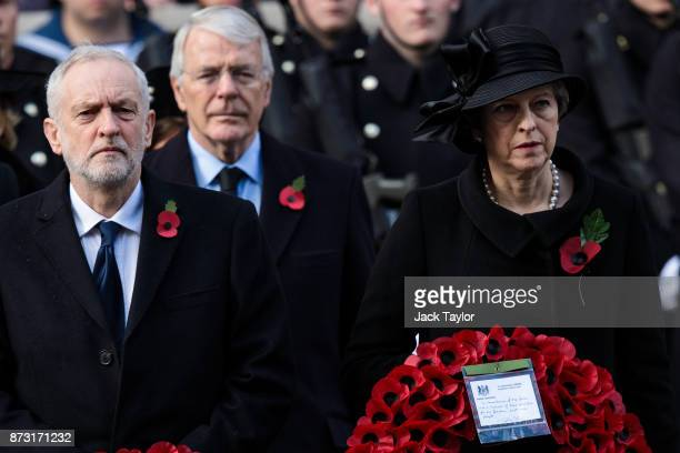 British Prime Minister Theresa May former Prime Minister John Major and Labour Leader Jeremy Corbyn hold wreaths during the annual Remembrance Sunday...
