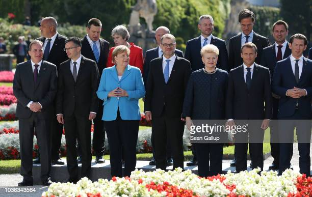 British Prime Minister Theresa May German Chancellor Angela Merkel and other leaders arrive for the family photo on the second day of an informal...