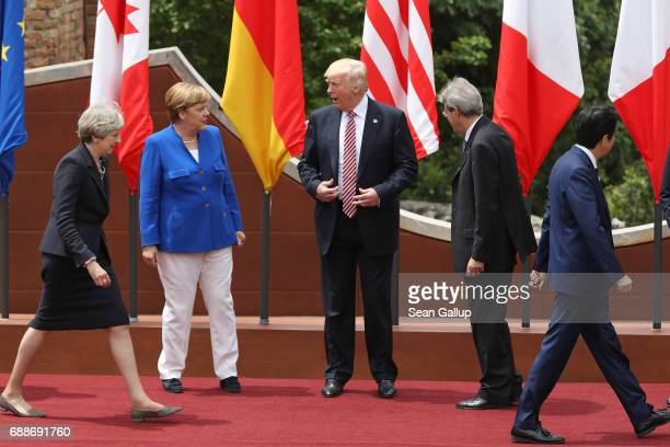 British Prime Minister Theresa May German Chancellor Angela Merkel US President Donald Trump Italian Prime Minister Paolo Gentiloni and Japanese...