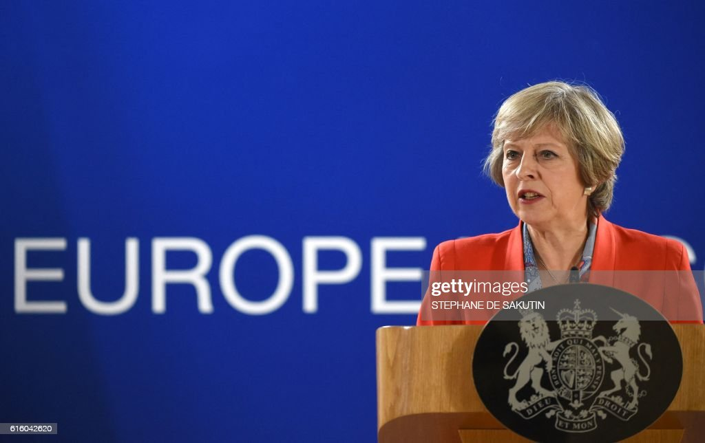 British Prime minister Theresa May gives a press conference on the second day of a European Union leaders summit at the European Council, in Brussels, on October 21, 2016. / AFP / STEPHANE