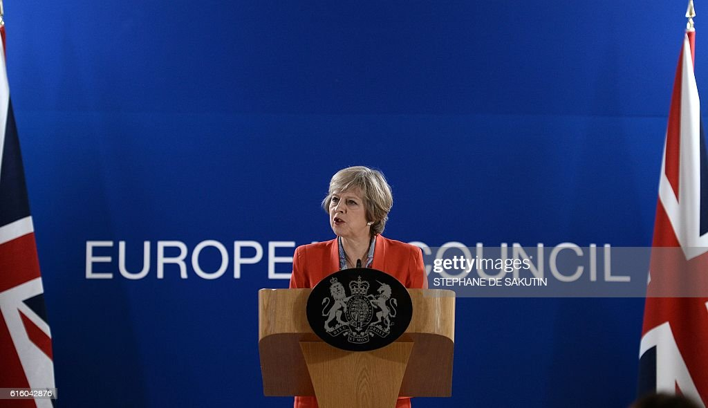 British Prime minister Theresa May gives a press conference on the second day of a European Union leaders summit on October 21, 2016 at the European Council, in Brussels. / AFP / STEPHANE