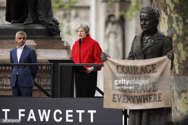 British Prime Minister Theresa May gives a speech as Mayor of London Sadiq Khan looks on during the official unveiling of a statue in honour of the...