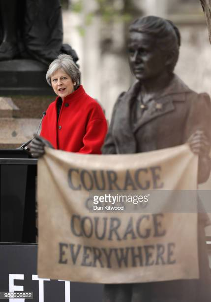 British Prime Minister Theresa May gives a speech during the official unveiling of a statue in honour of the first female Suffragist Millicent...