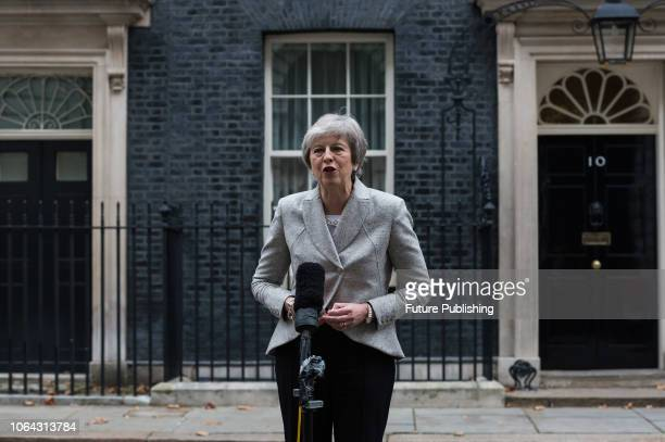 British Prime Minister Theresa May gives a statement to the media outside 10 Downing Street following the announcement earlier today that UK and EU...