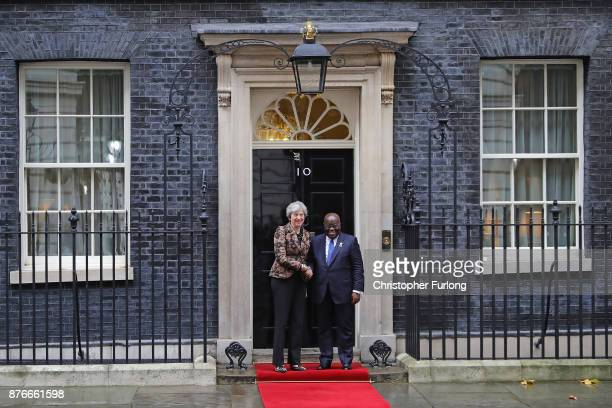 British Prime Minister Theresa May greets Ghana's President Nana AkufoAddo outside number 10 Downing Street on November 20 2017 in London England...