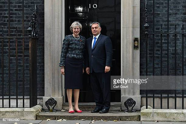 British Prime Minister Theresa May greets her Hungarian counterpart Viktor Orban in Downing Street on November 9 2016 in London England Mrs May led...