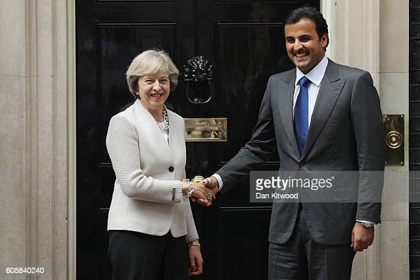 British Prime Minister Theresa May greets His Highness Sheikh Tamim bin Hamad al Thani The Emir of Qatar outside 10 Downing Street on September 15...