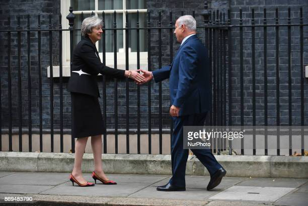 British Prime Minister Theresa May greets Israel's Prime Minister Benjamin Netanyahu at Downing Street London on November 2 2017 The prime minister...
