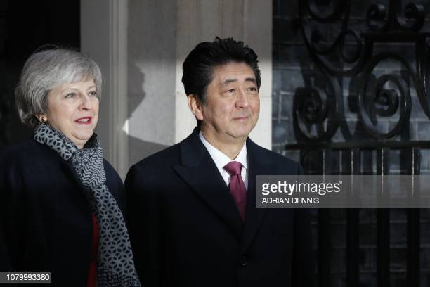 British Prime Minister Theresa May greets Japan's Prime Minister Shinzo Abe outside 10 Downing Street in central London on January 10 2019