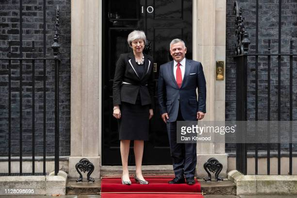 British Prime Minister Theresa May greets King Abdullah II of Jordan outside number 10 Downing Street on February 28 2019 in London England King...