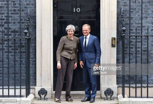 British Prime Minister Theresa May greets President of the European Council, Donald Tusk in Downing Street on September 26, 2017 in London, England....