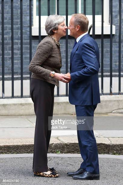 British Prime Minister Theresa May greets President of the European Council Donald Tusk in Downing Street on September 26 2017 in London England...
